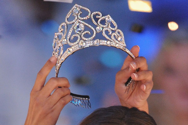 NICE, FRANCE - DECEMBER 05: Miss Normandie Malika Menard (L) receives the crown from 2009  Miss France Chloe Mortaud (R) during the 2010 Miss France Beauty pageant at Palais Nikaia on December 5, 2009 in Nice, France.  (Photo by Pascal Le Segretain/Getty Images) *** Local Caption *** Malika Menard;Chloe Mortaud